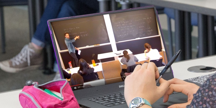 Student watches class on her laptop