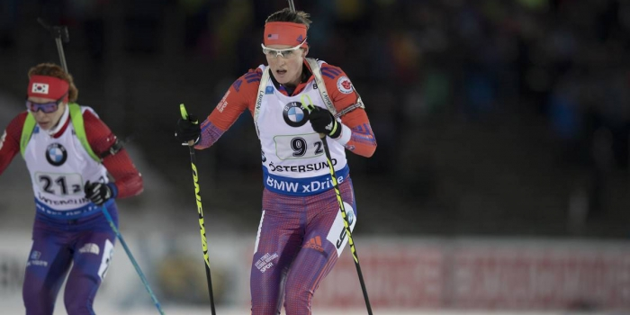 Clare Egan '10 skis in a biathlon event