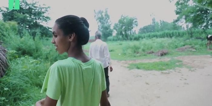 Wellesley student Manvi Chaudhury walks through her village in Uttar Pradesh, India