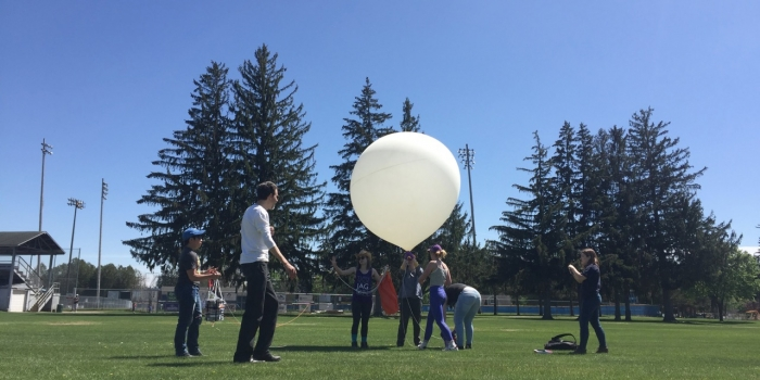Wellesley students in Astronomy 202 perform finishing touches on their semester-long research project before its launch.