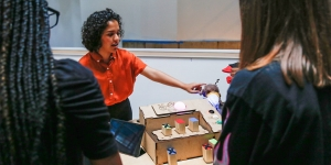 A student explains her summer research, which focuses on teaching bioethics to elementary school students.