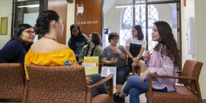 students talking outside of Rebecca Garcia's office, located on the second floor of Schneider.