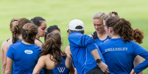 atheletes in a huddle