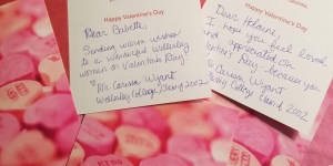 Two valentines cards with writing.