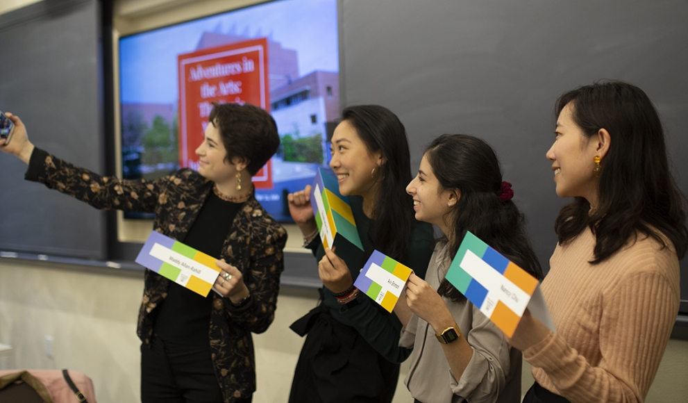 Four students take a selfie with their Tanner name tags before giving their presentation at Tanner 2019