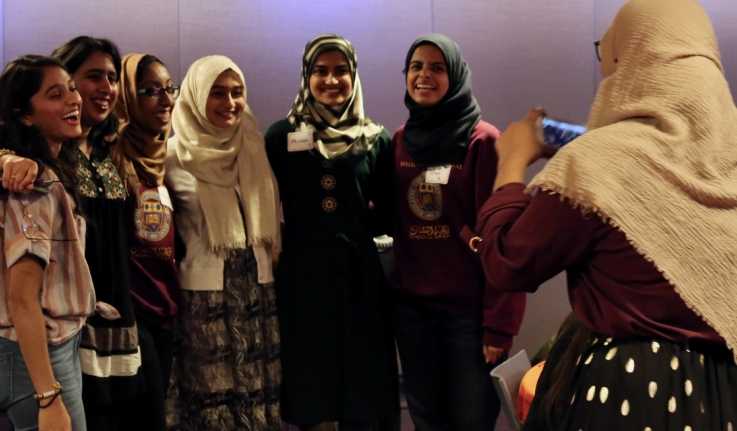 Students celebrate the 30th anniversary of Al-Muslimat by taking a photo after an event.