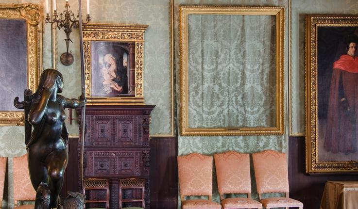 An empty frame at the Isabella Stewart Gardner Museum.
