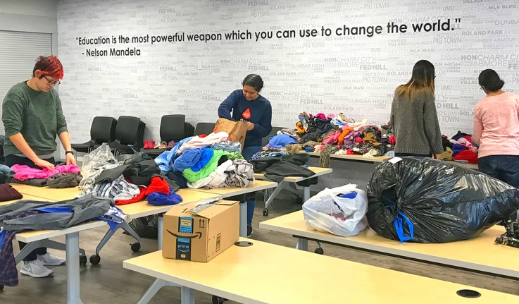 Wellesley students sort clothing in a Baltimore warehouse on an Alternative Break.