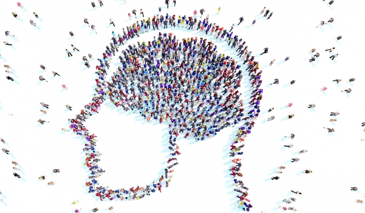 People standing in the shape of a human brain