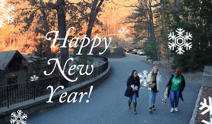 Three students walk a pathway to Lake House. Text reads: Happy New Year
