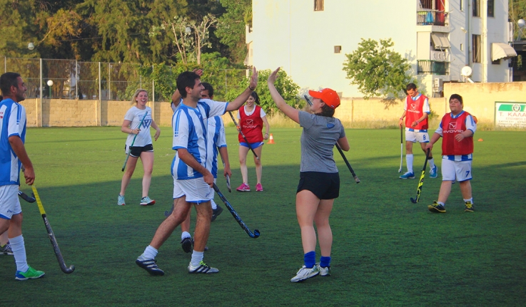 High fives and smiles for Wellesley Field Hockey players abroad