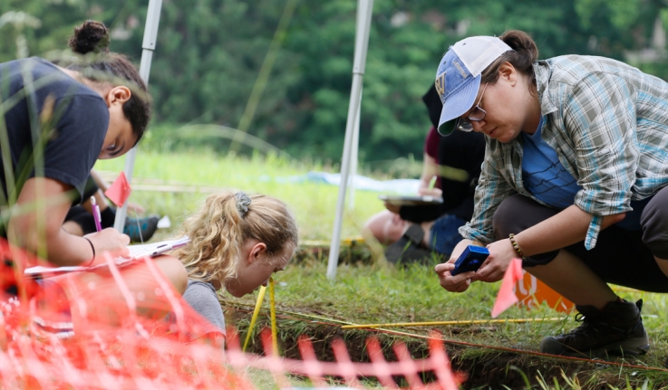 A visiting professor and students document their finds at a dig site on campus.