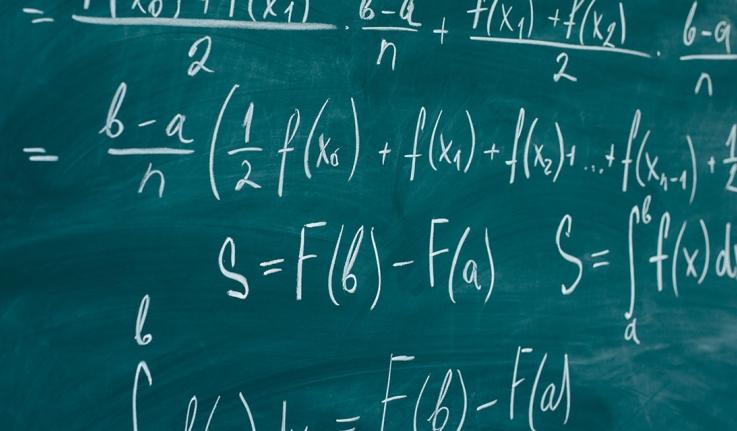 Math equations on a chalkboard