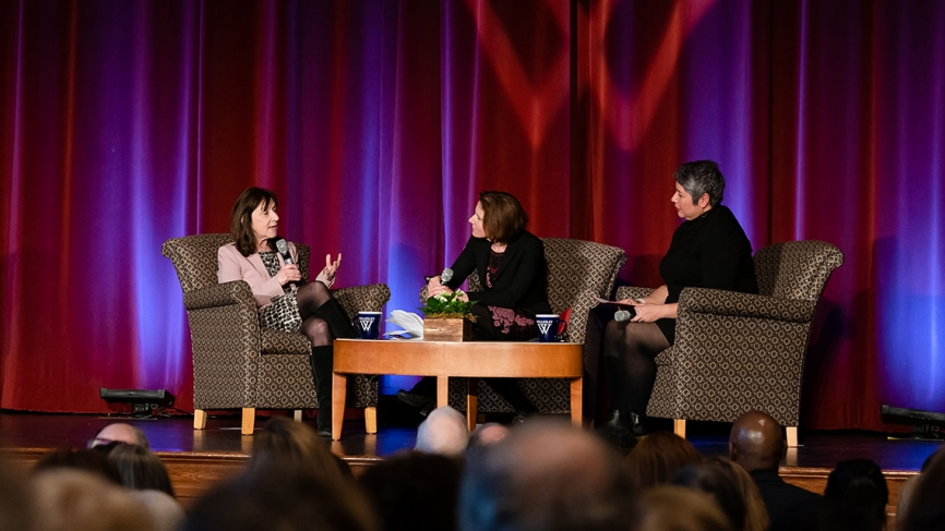 Two professors moderate a Q&A on stage with Jane Mayer