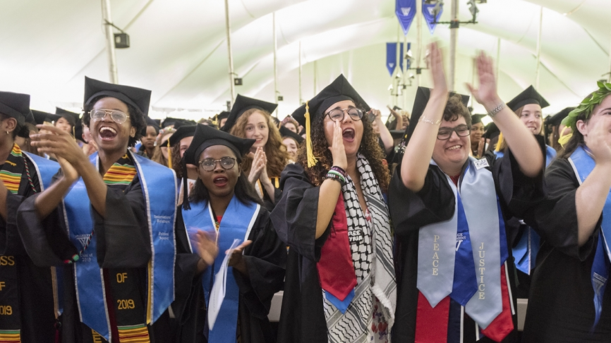 Students cheer in the tent.