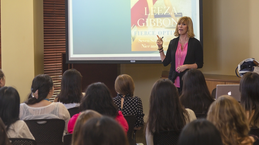 Leeza Gibbons stands at the front of a lecture hall speaking to summer program recipients.