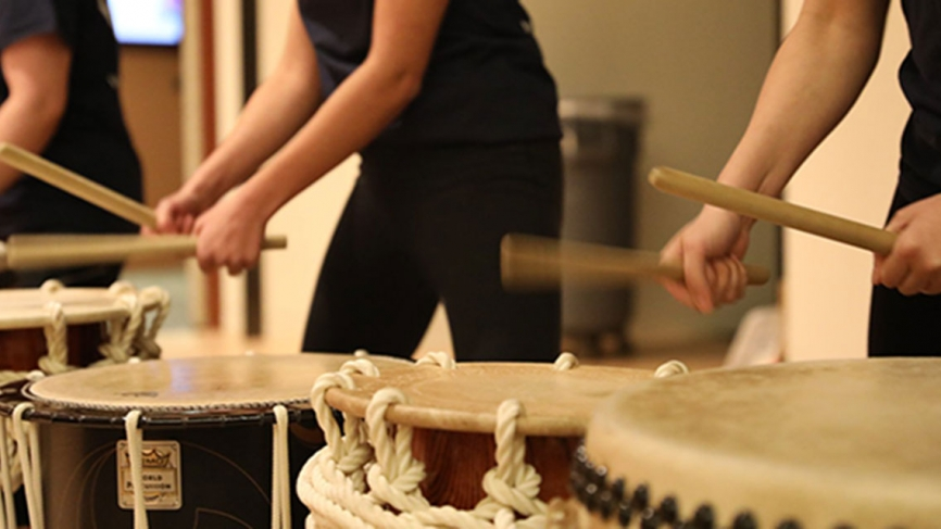 Students play Japanese drums.