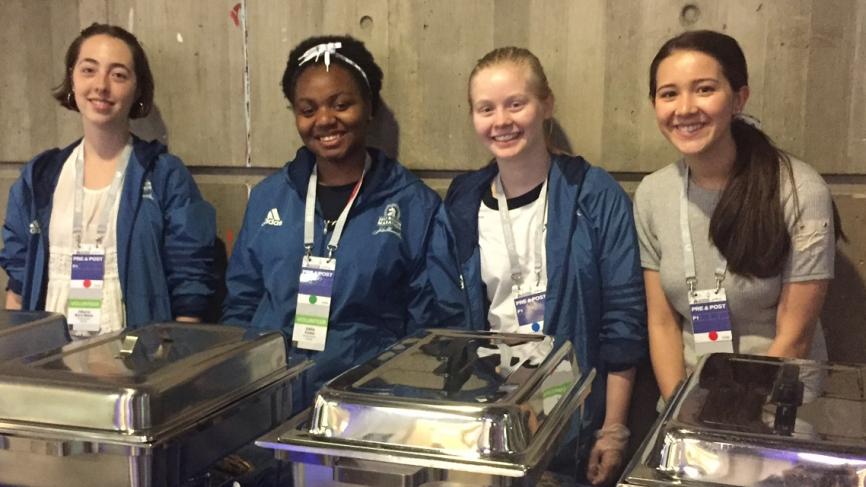 Student volunteers preparing to serve runners
