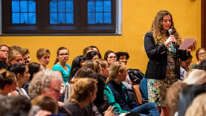 A student asks a question from the audience.