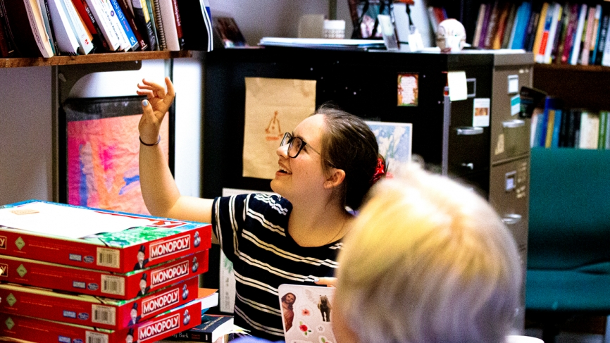 A student points to something on a shelf.