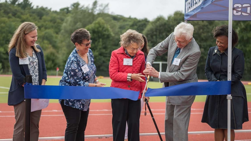 Donors cut a ceremonial ribbon before a game.