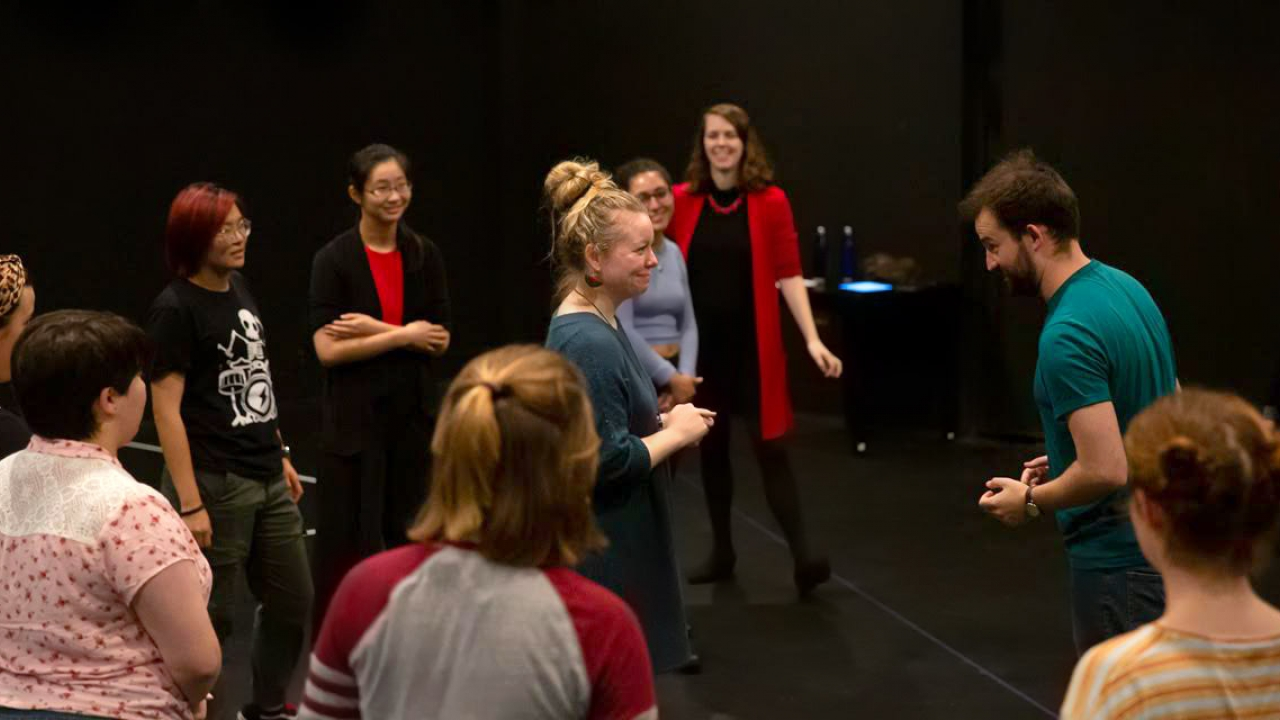 Students work with professional actors in a black box theatre