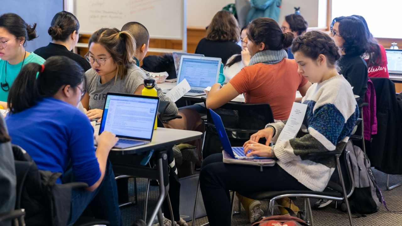 Students work on laptops at Wellesley's Wikipedia Edit-a-Thon