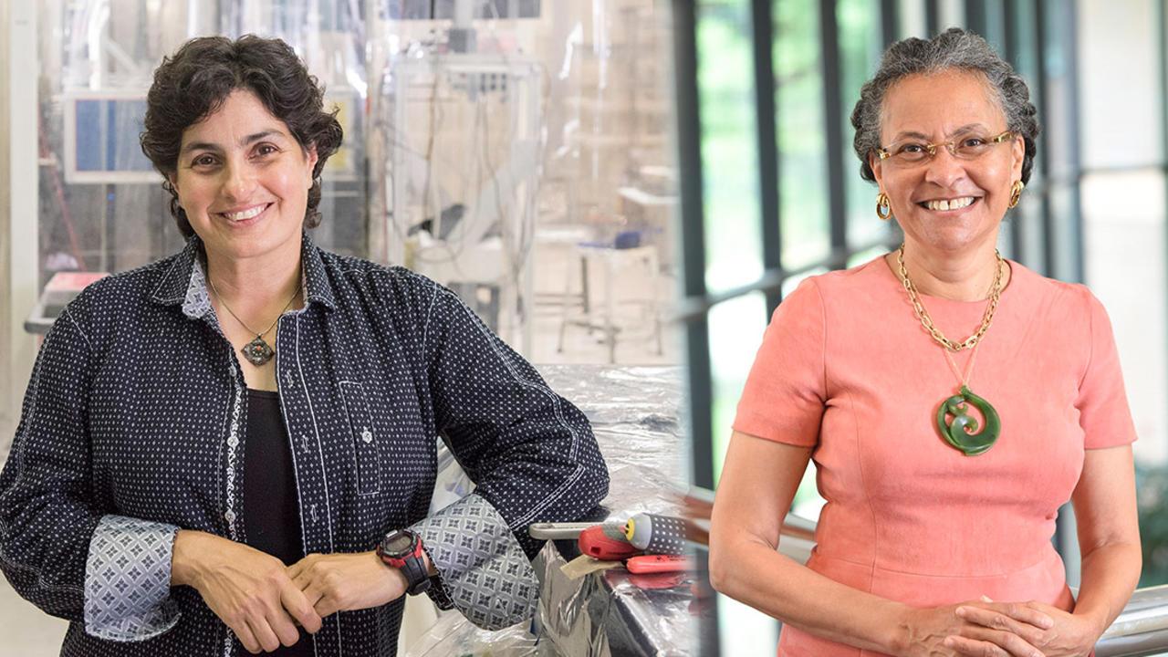 Camara Jones and Negris Mavalvala stand posed, looking into the camera