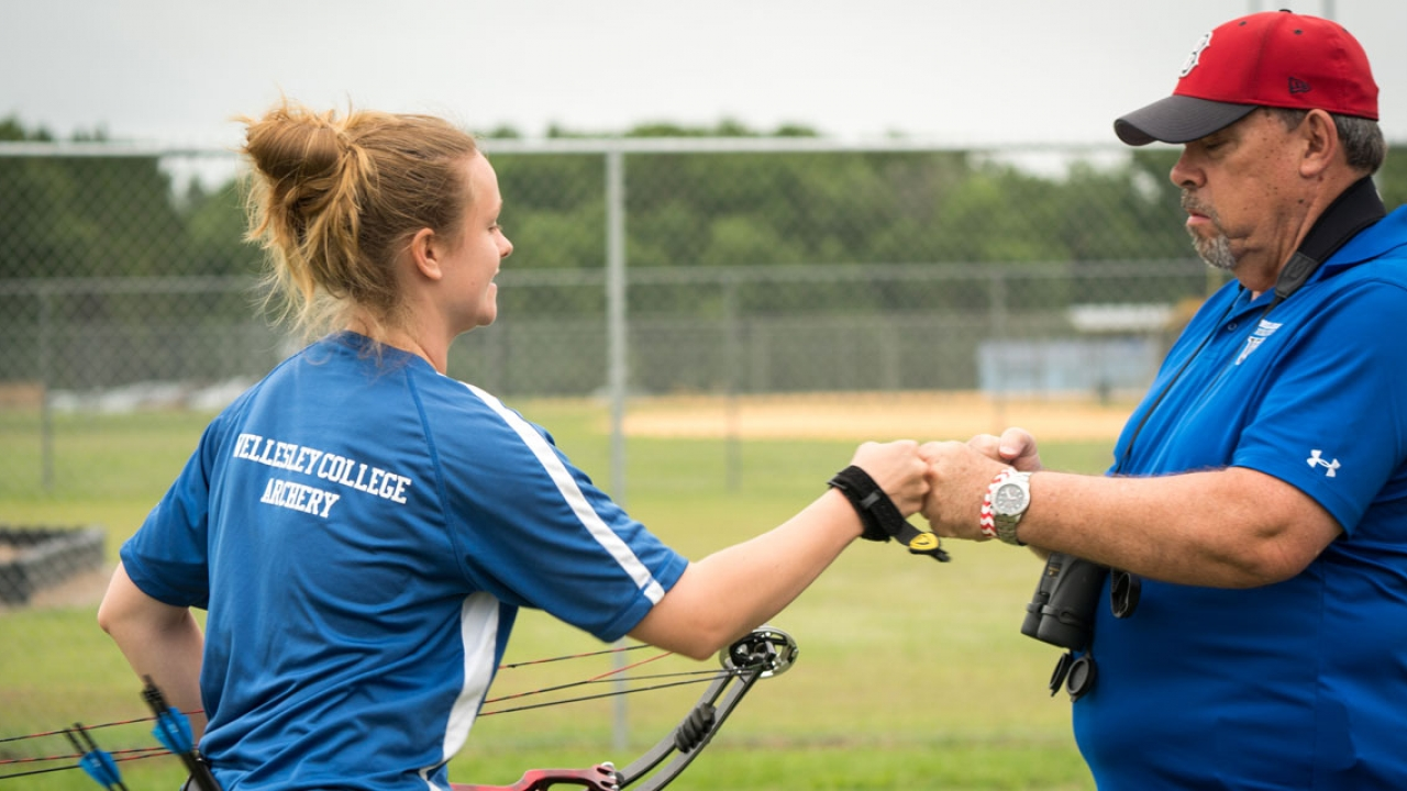Karley Bussow '18 and Wellesley archery coach E.G. LeBre prepare for the U.S. National Outdoor Collegiate Championships.