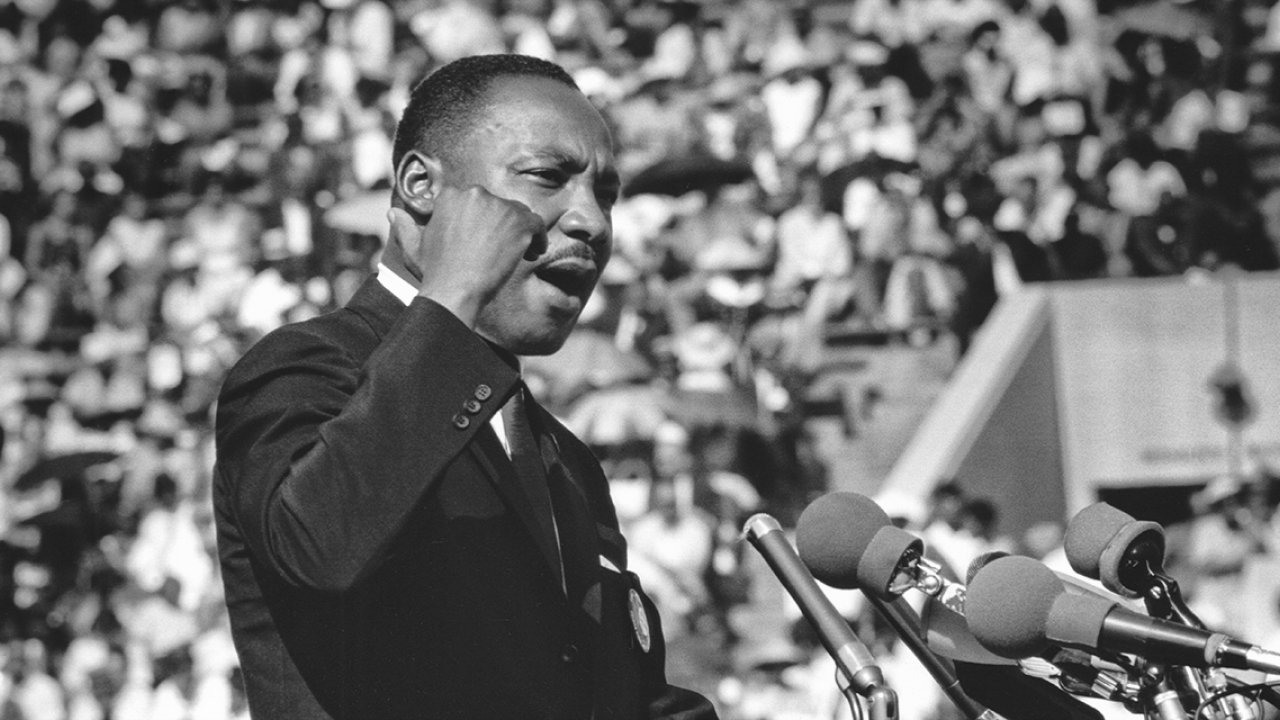 Dr. Martin Luther King makes a speech at the Illinois Rally for Civil Rights at Soldier Field