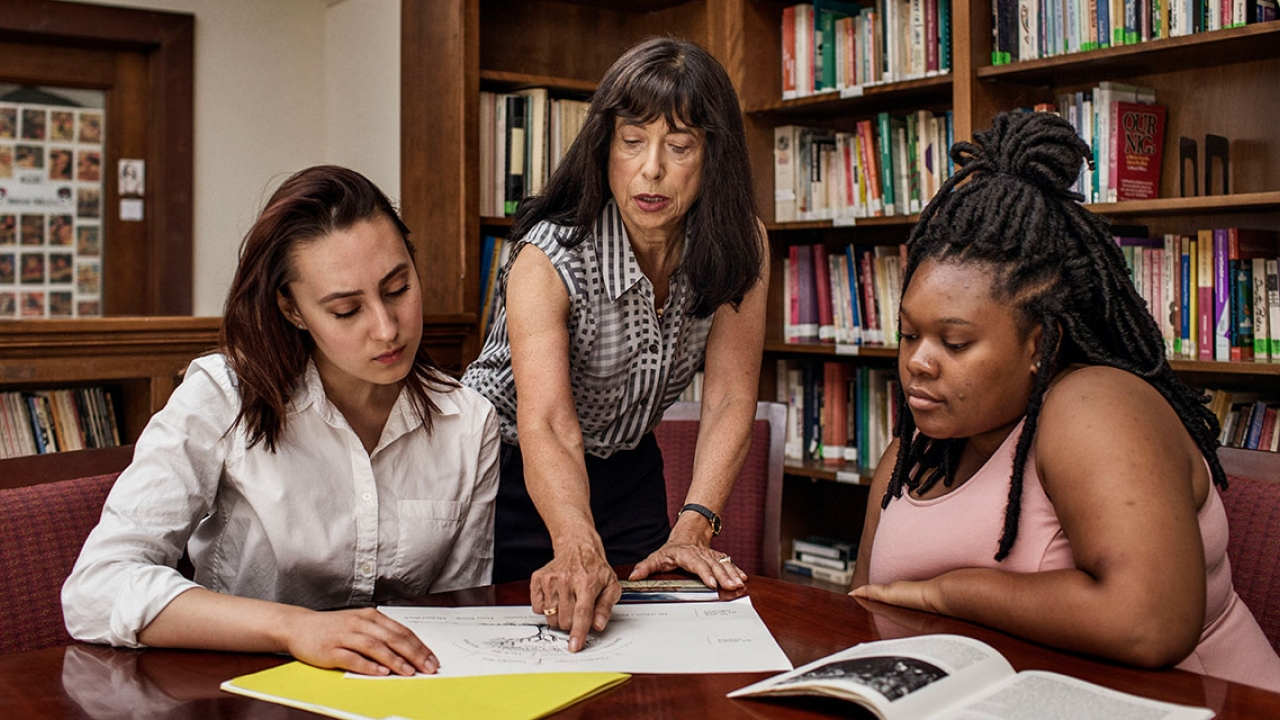 Rosanna Hertz works with two students in a classroom