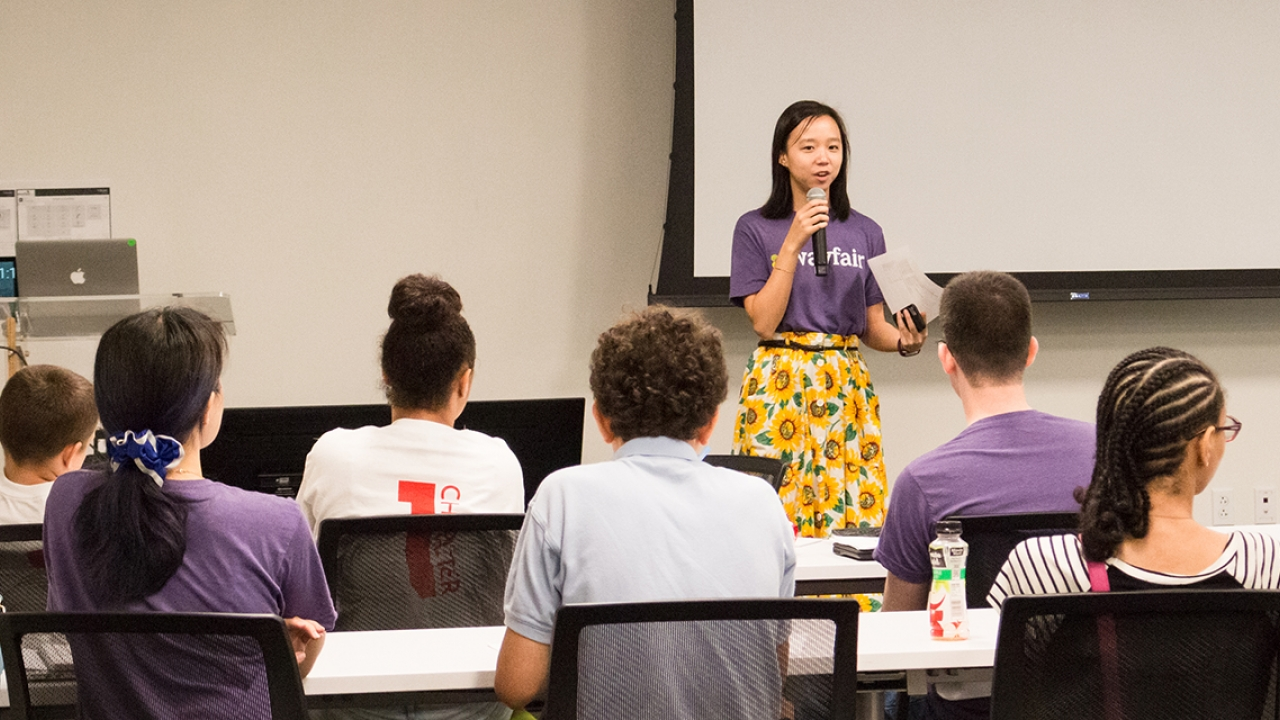 Karina Lin speaks in front of a classroom of middle school students.