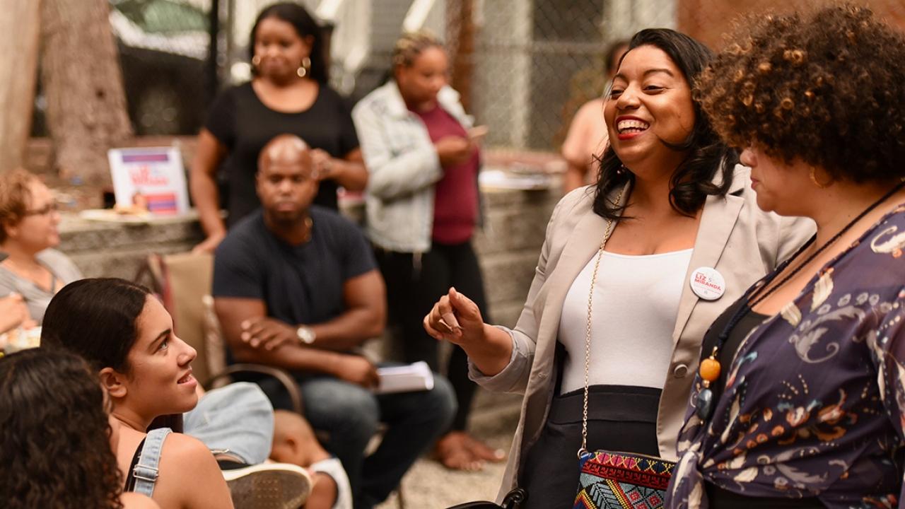 Liz Miranda '02 talks to constituents at a campaign event. (2018)