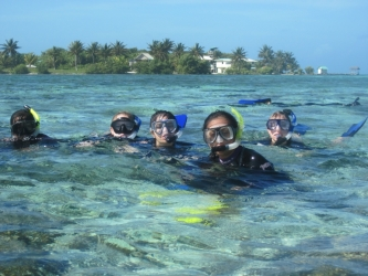 Students researching coral reefs in Glover's Reef, Belize