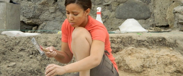 student in an archeology dig