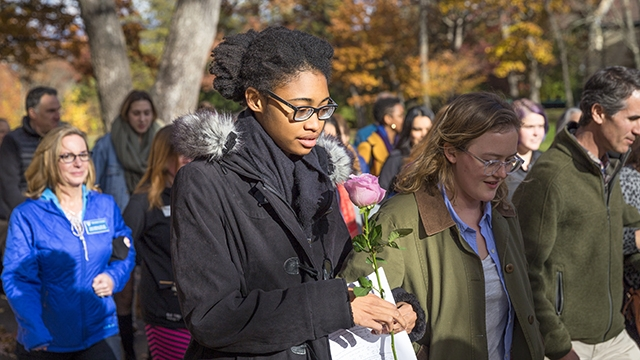 Community joins President Johnson in a peace walk through campus.